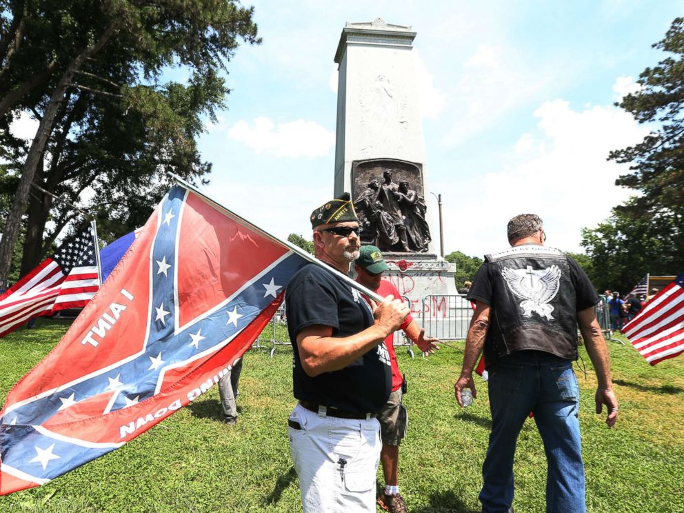 PHOTO: Steve Stepanek of St. Louis waves a Confederate flag at the Confederate monument in Forest Park on June 3, 2017 in St. Louis.