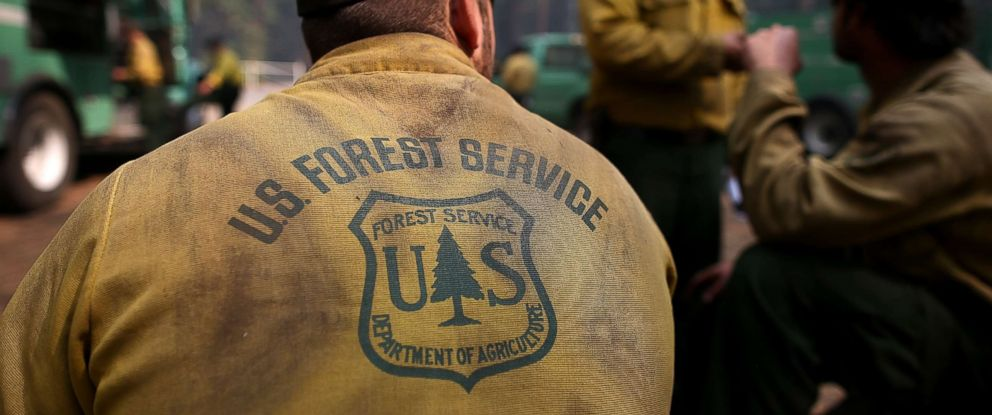 PHOTO: U.S. Forest Service firefighters take a break from battling the Rim Fire at camp Mather near Groveland, Calif., Aug. 25, 2013.