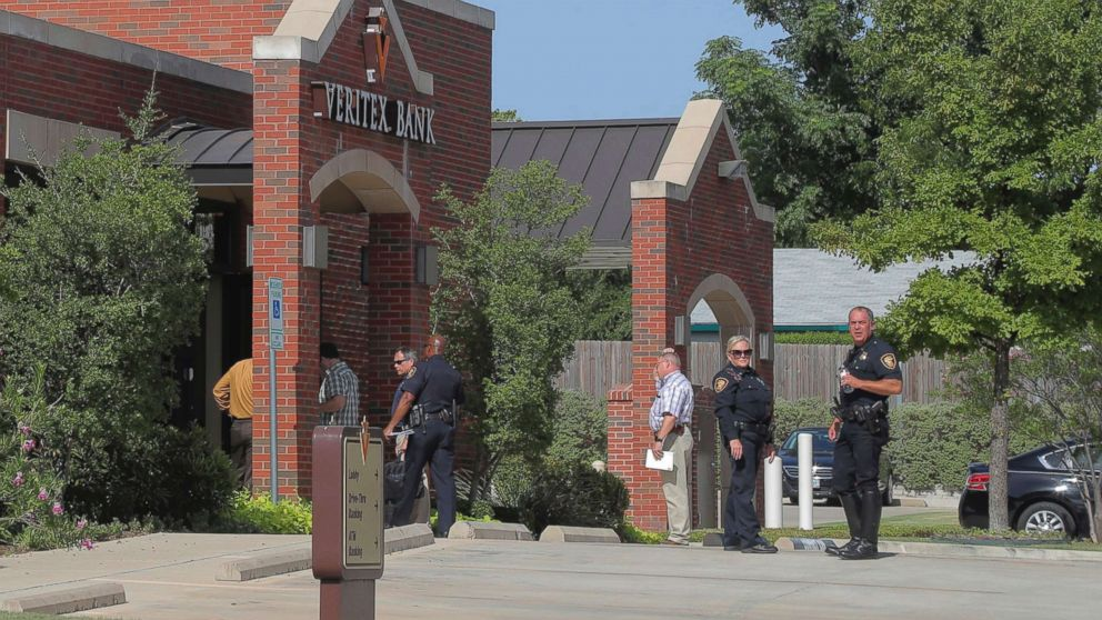 Police investigate a robbery and shooting at Veritex Bank, July 19, 2018, in Fort Worth, Texas.