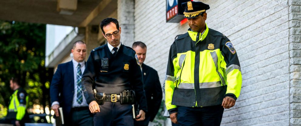 PHOTO: DC police Commander Melvin Grisham, right, walks with police officers outside the FOX 5 building, after a security guard shot a man attempting to break into the TV station, Oct. 22, 2018.