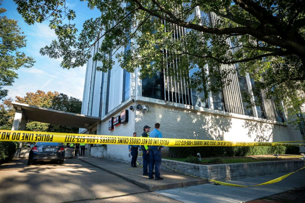 PHOTO: Police stand outside the FOX 5 building after a security guard shot a man attempting to break into the TV station in the Friendship Heights neighborhood of Washington, DC, Oct. 22, 2018.