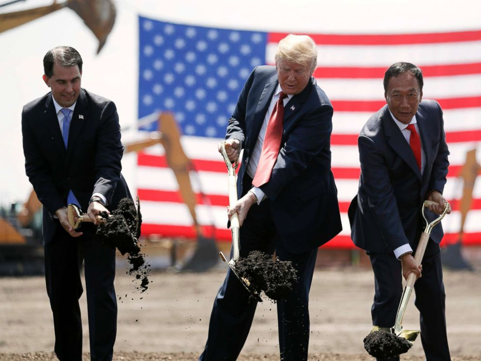PHOTO: President Donald Trump, center, along with Wisconsin Gov. Scott Walker, left, and Foxconn Chairman Terry Gou participate in a groundbreaking event for the new Foxconn facility in Mt. Pleasant, Wis., June 28, 2018.