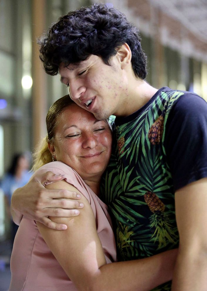 PHOTO: Francisco Galicia embraces his mother Sanjuana Galicia at the McAllen, Texas, Central Station, Wednesday, July 24, 2019.