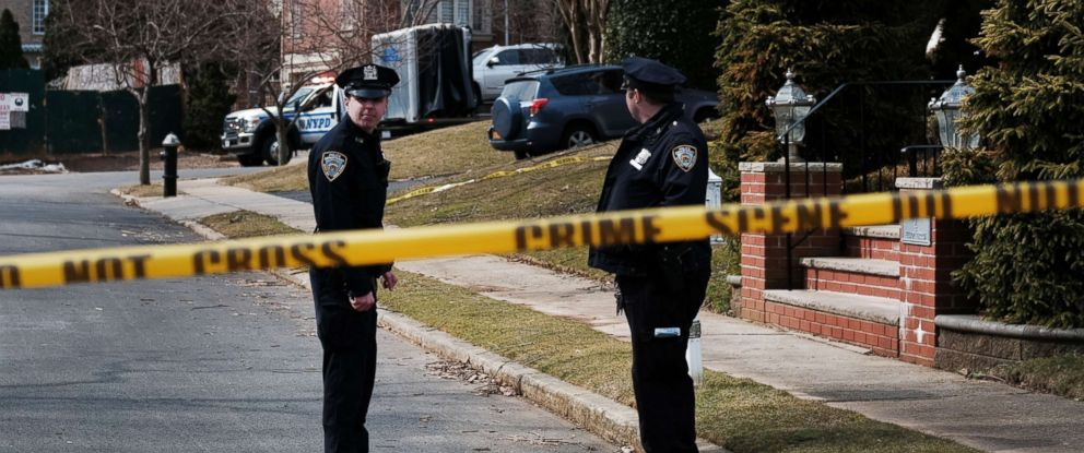 "PHOTO: Police stand along the street where reputed mob boss Francesco ""Franky Boy"" Cali lived and was gunned down on March 14, 2019, in the Staten Island borough of New York."