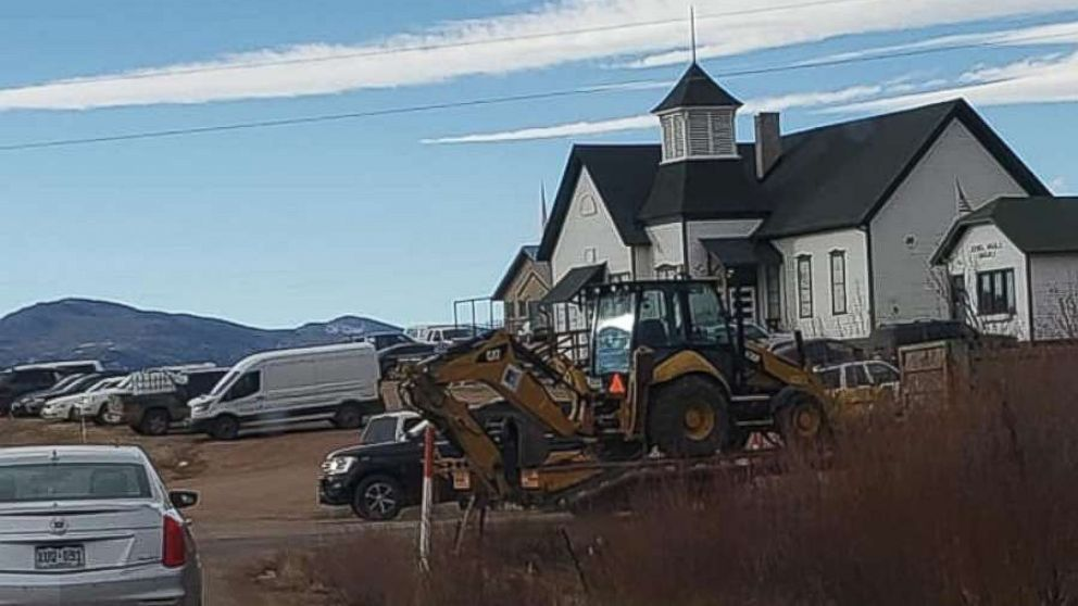 Authorities brought in an excavator to begin digging on the property of Patrick Frazee in Florissant, Colo., on Saturday, Dec. 15, 2018. Frazee's fiancee has been missing for 24 days.