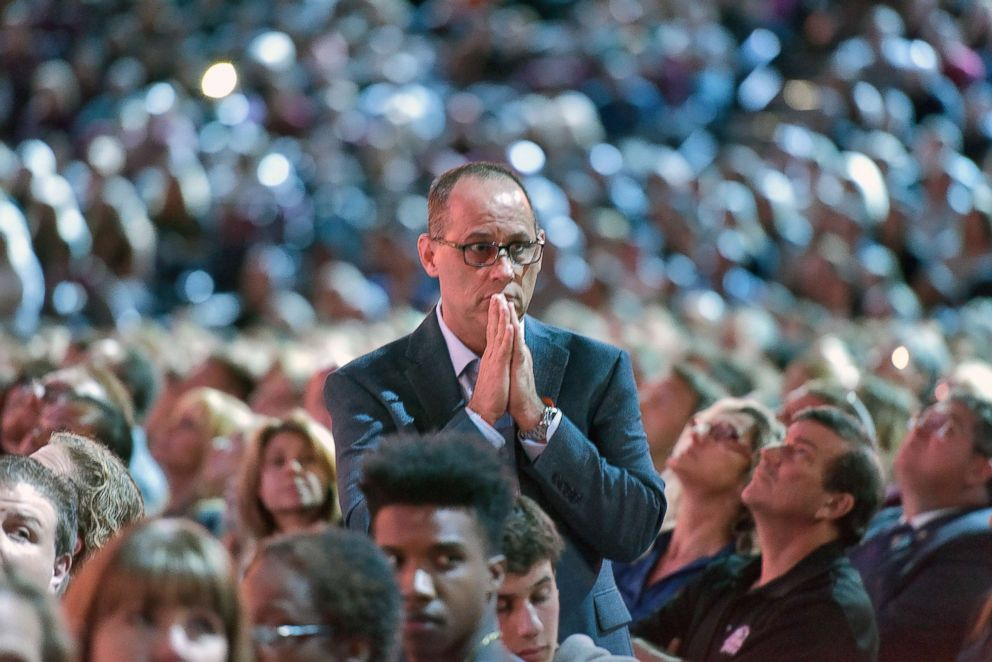 Fred Guttenberg watches a monitor honoring the 17 students and teachers who were killed at Marjory Stoneman Douglas High School, during a town hall meeting on Feb. 21, 2018, in Sunrise, Fla.