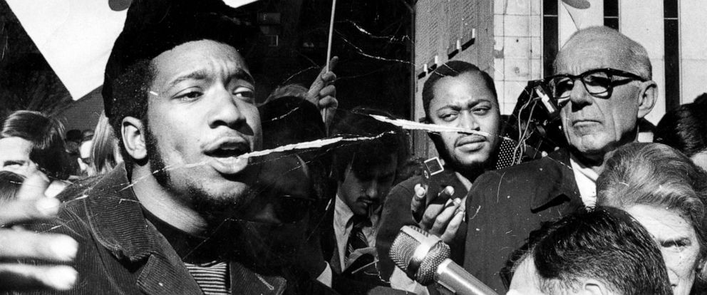 PHOTO: Fred Hampton, left, head of the Illinois Black Panthers, and Dr. Benjamin Spock, right, attend a rally against the trial of eight people accused of conspiracy to start a riot at the Democratic National Convention, Oct. 29, 1969.