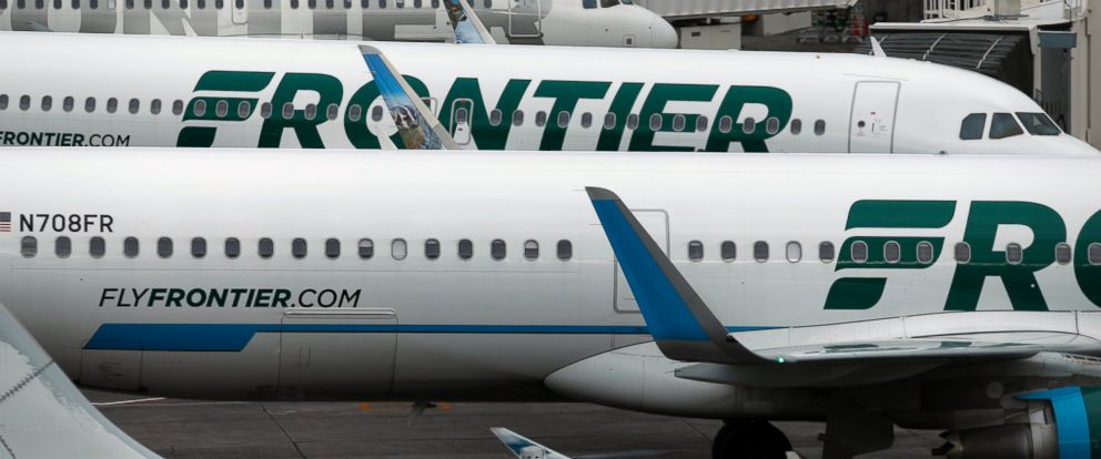 A man allegedly punched a service dog and pregnant woman on a Frontier Airlines flight to Orlando, Fla., on Thursday, May 17, 2018.
