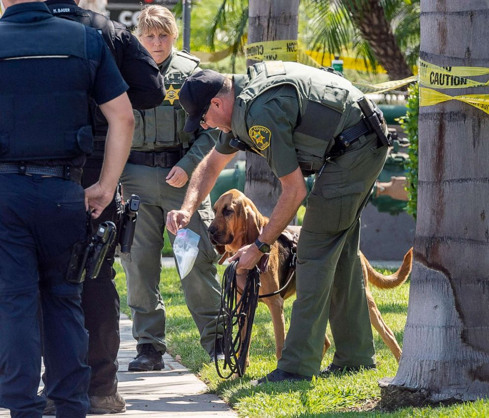 PHOTO: Police use a bloodhound while searching for a suspect that stabbed to death a retired Cal State Fullerton administrator, Aug. 19, 2019 in Fullerton, Calif.