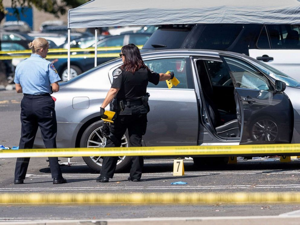 PHOTO: Police investigate a car where a retired Cal State Fullerton administrator was stabbed to death, Aug. 19, 2019 in Fullerton, Calif.