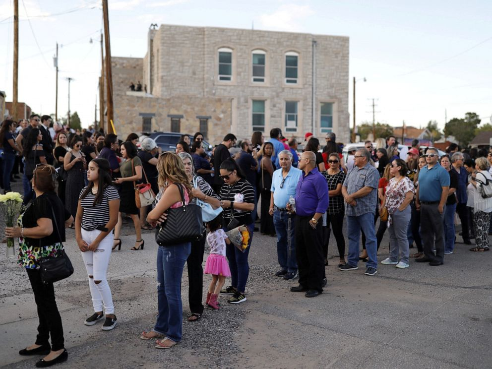 PHOTO: Mourners form a line outside the La Paz Faith memorial center during the public visitation service of Walmart shooting victim Margie Reckard, to which her husband Antonio Basco had invited the community in El Paso, Texas, U.S. August 16, 2019.
