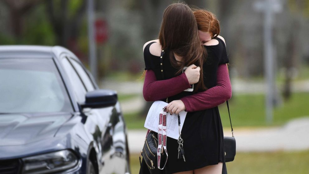 Mourners react as they leave the funeral services for slain Marjory Stoneman Douglas student Carmen Schentrup, Feb. 20, 2018, at St. Andrew Catholic Church in Coral Springs, Fla.