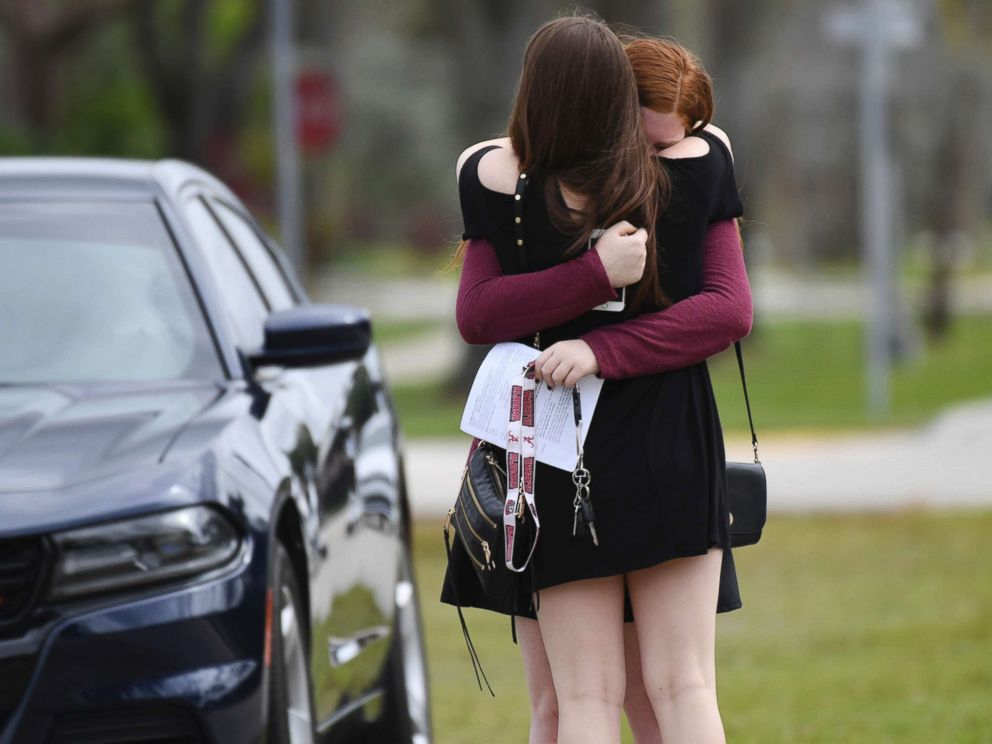 PHOTO: Mourners react as they leave the funeral services for slain Marjory Stoneman Douglas student Carmen Schentrup, Feb. 20, 2018, at St. Andrew Catholic Church in Coral Springs, Fla.
