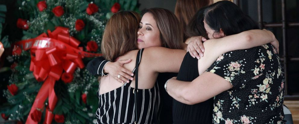 PHOTO: Tearful mourners hug outside a funeral home as they arrive to attend a wake for Elsa Mendoza, who was killed in the El Paso mass shooting, in Juarez, Mexico, Aug. 7, 2019.