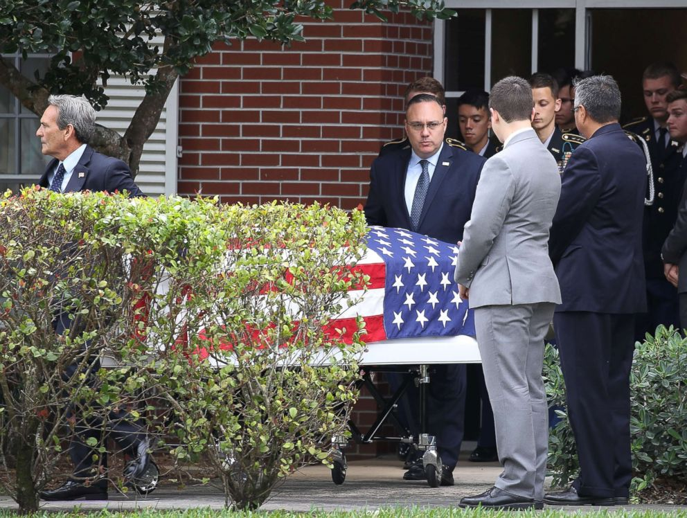 PHOTO: The flag draped coffin of Alaina Petty is taken out after her funeral at The Church of Jesus Christ of Latter-day Saints, Feb. 19, 2018, in Coral Springs, Fla.