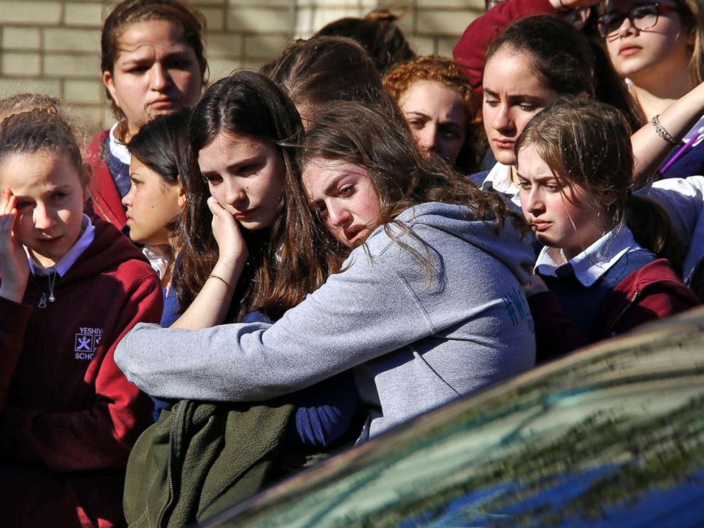 PHOTO: Students from the Yeshiva School in Pittsburgh stand outside Beth Shalom Synagogue after attending the funeral service for Joyce Fienberg, Oct. 31, 2018.