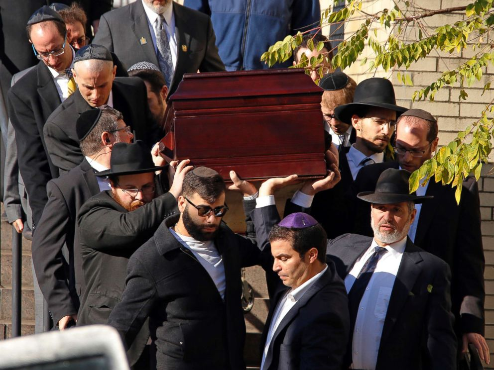 PHOTO: Pallbearers carry the casket of Joyce Fienberg from the Beth Shalom Synagogue following a funeral service in Pittsburgh, Oct. 31, 2018.