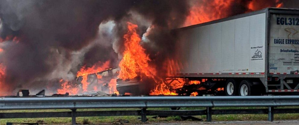 PHOTO: Flames engulf vehicles after a fiery crash along Interstate 75, about a mile south of Alachua, near Gainesville, Fla., Jan. 3, 2019.