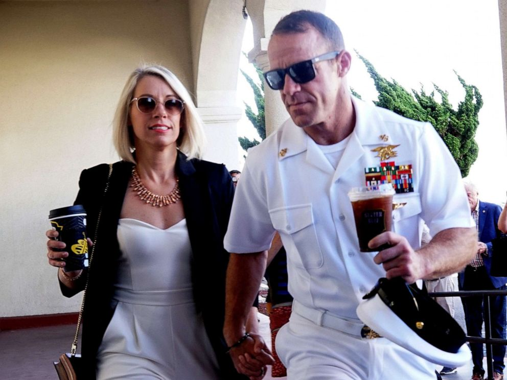 PHOTO: Navy Special Operations Chief Edward Gallagher walks into military court with his wife Andrea Gallagher, July 2, 2019, in San Diego, Calif.