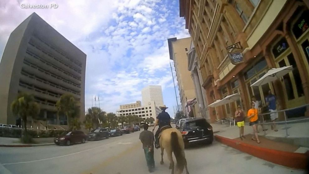 PHOTO: Galveston police released bodycam footage of Donald Neely being walked through Galveston by officers on horseback.