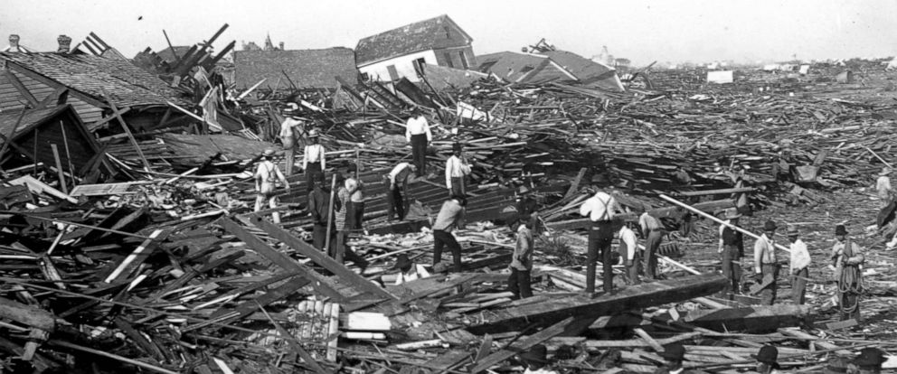 PHOTO: Men use ropes to pull away the debris of houses in order to look for bodies, after the Galveston Hurricane of 1900.