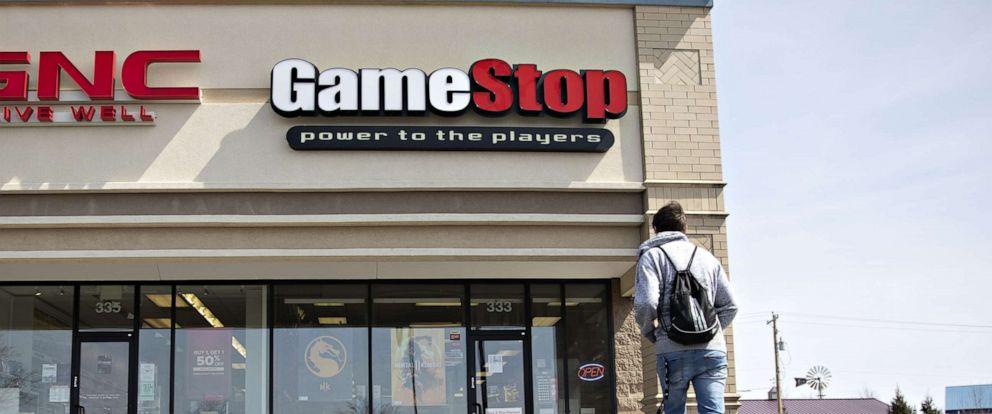 PHOTO: A shopper walks toward a GameStop store in Ottawa, Ill., April 1, 2019.