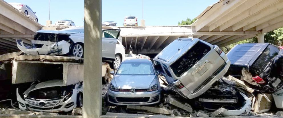 PHOTO: A multi-story parking garage collapsed in Irving, Texas, July 31, 2018, burying 21 vehicles under thousands of pounds of debris.