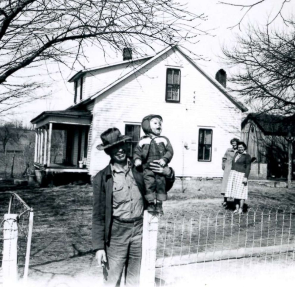 PHOTO: U.S. Army 1st Lt. Garlin M. Conner with his son, Paul, at his parents home. Conners wife Pauline, left, and sister-in-law Thelma, right, are standing in the background.