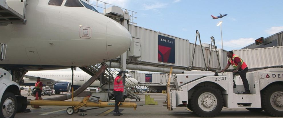 PHOTO: A Delta jet awaits pushback from a gate at Hartsfield-Jackson Atlanta International Airport.