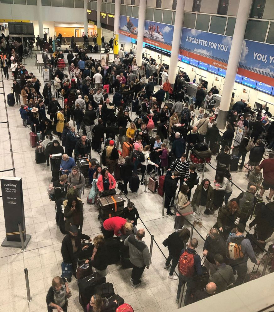 PHOTO: Queues of passengers wait at the check-in desks at Gatwick Airport, as the airport remains closed with flights delayed or diverted to other airports, after drones were spotted over the airfield last night and this morning Thursday Dec. 20, 2018.