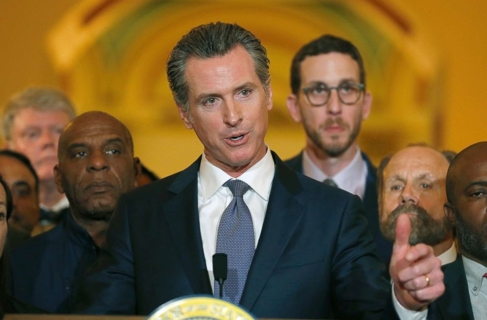 PHOTO: Flanked by lawmakers, Gov. Gavin Newsom discusses his decision to place a moratorium on the death penalty during a news conference, March 13, 2019, in Sacramento, Calif.