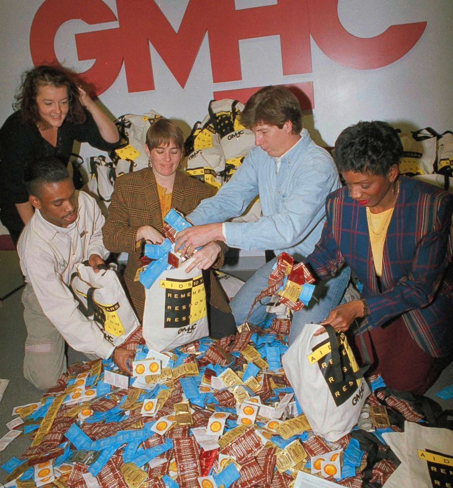 Volunteers at the Gay Mens' Health Crisis in New York load bags with condoms for distribution with leaflets promoting safe sex and AIDS awareness, Nov. 25, 1991.