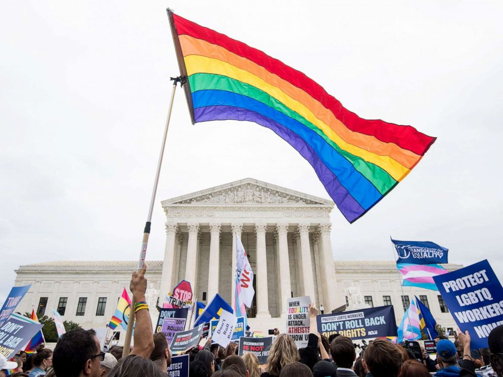 PHOTO: Protesters rally in front of the Supreme Court as it hears arguments on whether gay and transgender people are covered by a federal law barring employment discrimination on the basis of sex on Oct. 8, 2019.