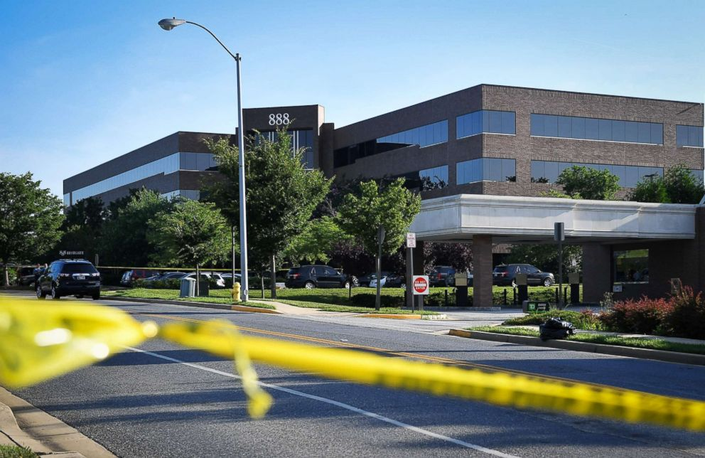 PHOTO: Police tape blocks access from a street leading to the building complex where The Capital Gazette is located in Annapolis, Md., June 29, 2018.