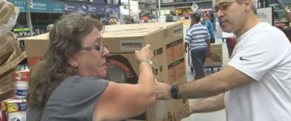PHOTO: Pam Brekke thanks fellow Florida resident Ramon Santiago after she failed to get a generator at Lowes Home Improvement store and he gave her his.
