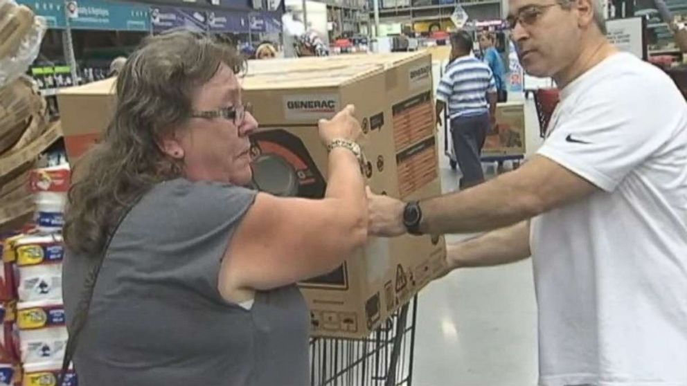 Pam Brekke thanks fellow Florida resident Ramon Santiago after she failed to get a generator at Lowe's Home Improvement store and he gave her his.