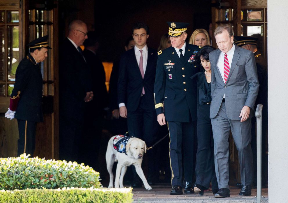 Former president Bush's service dog takes watch over casket in touching photo