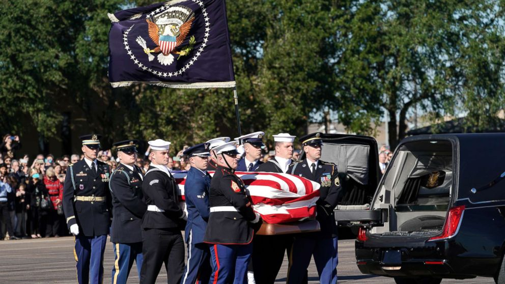 The flag-draped casket of former President George H.W. Bush is carried by a joint services military honor guard in Houston,  Dec. 3, 2018.