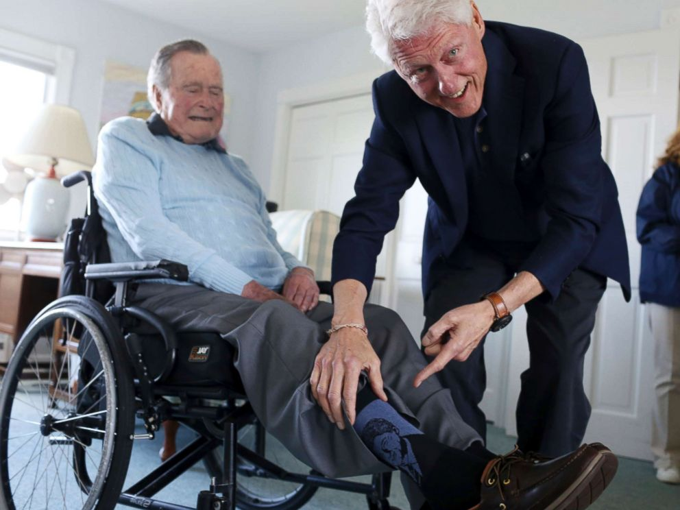 PHOTO: Former President Bill Clinton jokes with former President George H.W. Bush, as Bush shows off a pair of Bill Clinton socks, while Clinton visits Bush at his home in Kennebunkport, Maine, June 25, 2018.