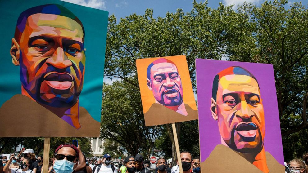 PHOTO: In this Aug. 28, 2020, file photo, protesters and activists carrying portraits of George Floyd attend the 'Commitment March: Get Your Knee Off Our Necks' march at the Lincoln Memorial in Washington, DC.