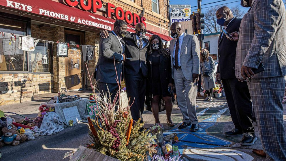 PHOTO: Members of George Floyd's family, including brother Philonise Floyd, and Floyd family lawyer Ben Crump visit a memorial at the site where George Floyd died while being arrested, after attending a press conference on March 12, 2021, in Minneapolis.