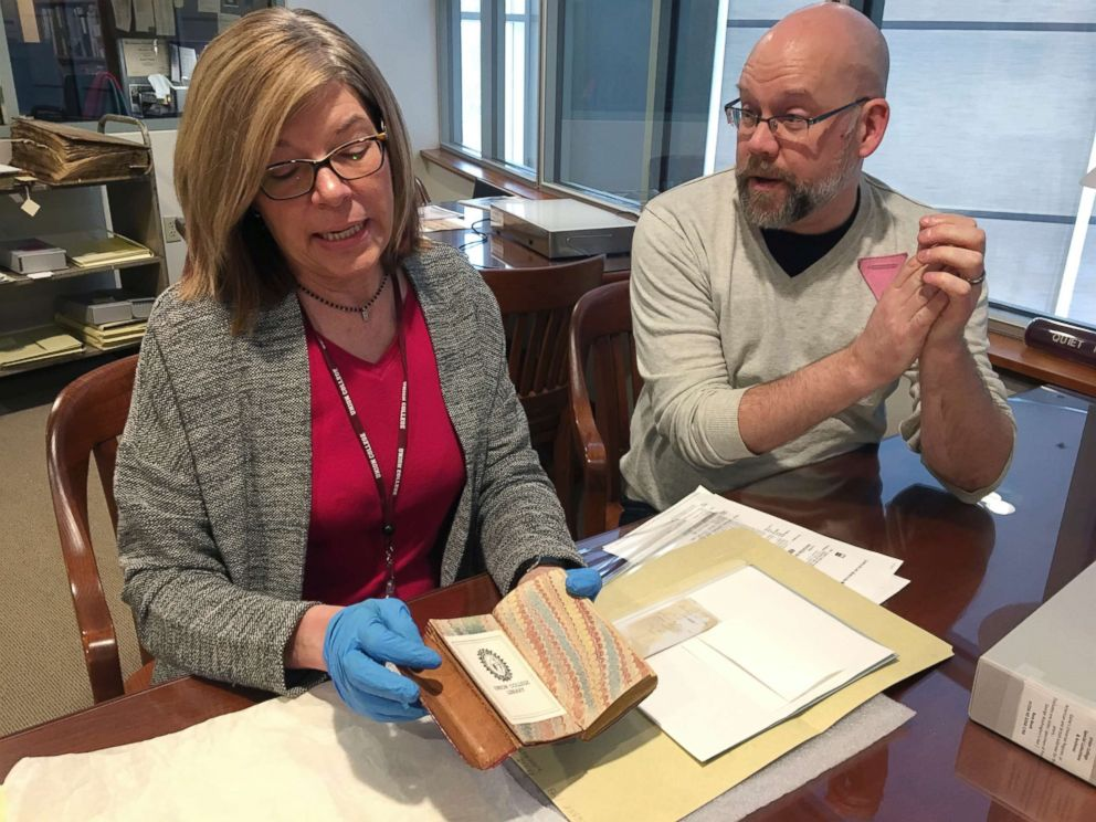 PHOTO: India Spartz, left, head of special collections and archives at Union College, and librarian John Myers look at an old almanac from the college archives in Schenectady, N.Y., Feb. 14, 2018.