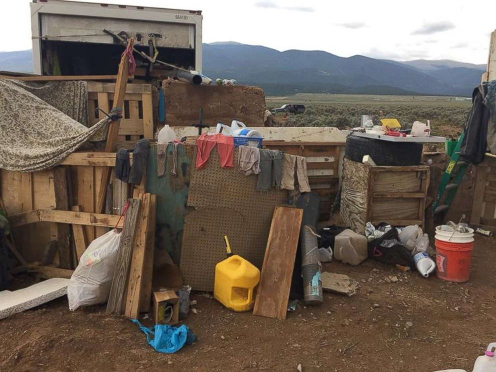 Eleven children were held with little food or water in a makeshift compound in Amalia, N.M., for an unknown period of time before police raided the location on Friday, Aug. 3, 2018.