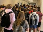 Student's school suspension revoked after her photo of crowded hallway goes viral
