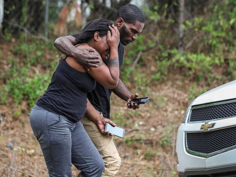 PHOTO: A couple of people leave a scene where a gunman reportedly shot a few Henry County police officers in Stockbridge, Ga., Thursday, April 4, 2019.