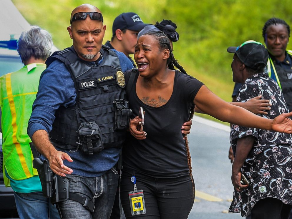 PHOTO: A woman believed to be related to ones involved in a hostage situation reacts as law enforcement on the scene tried to console them in Stockbridge, Ga., Thursday, April 4, 2019.