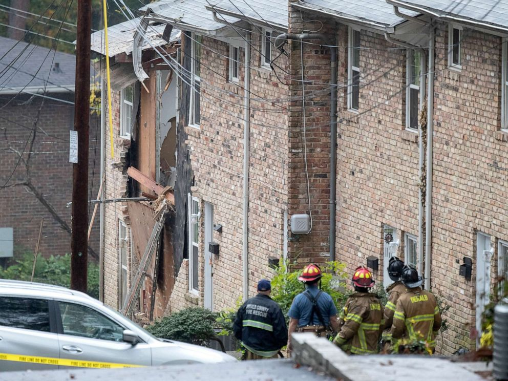 PHOTO: Fire officials look at the scene where an airplane crashed into an apartment complex, Wednesday, Oct. 30, 2019, in Atlanta.