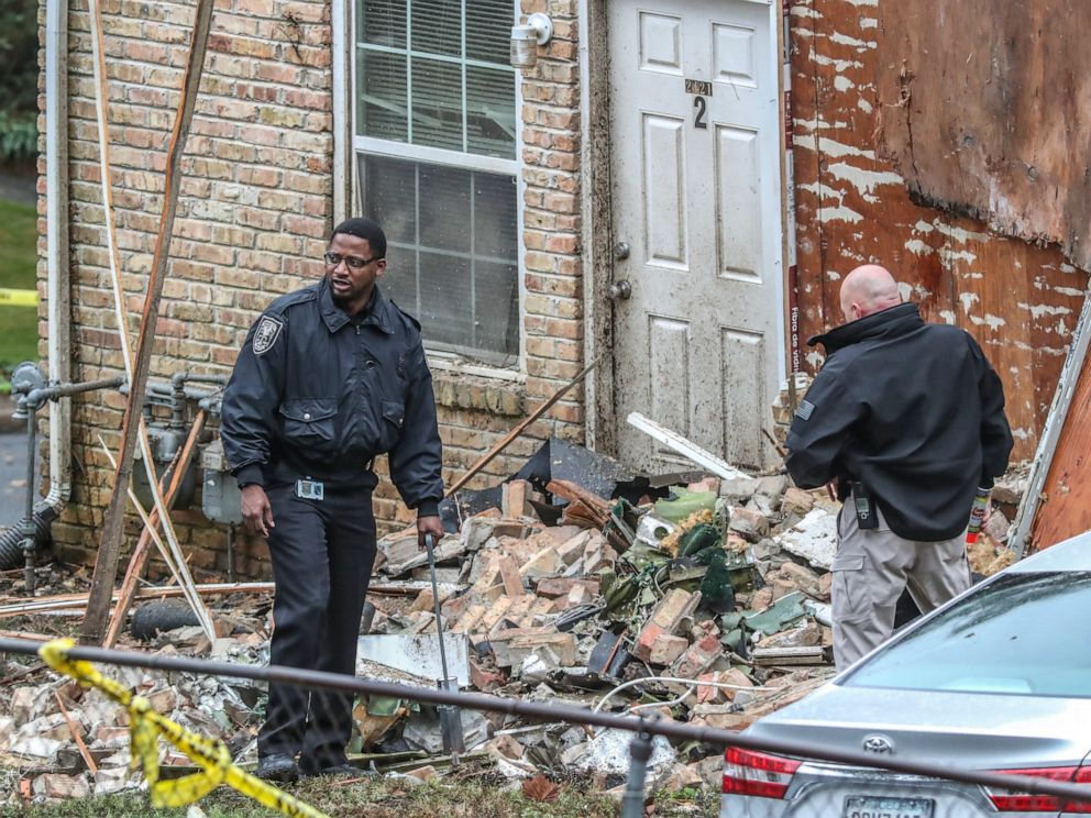 PHOTO: Officials look at the scene where an airplane crashed into an apartment complex, Oct. 30, 2019, in Atlanta.