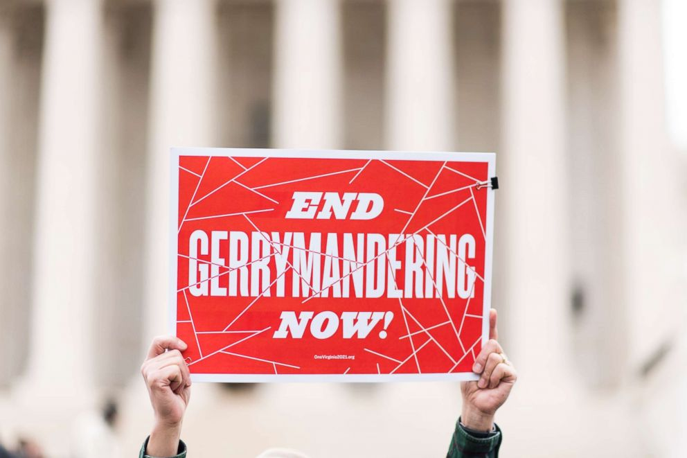 PHOTO: Gerrymandering activists gather on the steps of the Supreme Court as the court prepares to hear the the Benisek v. Lamone case, March 28, 2018.