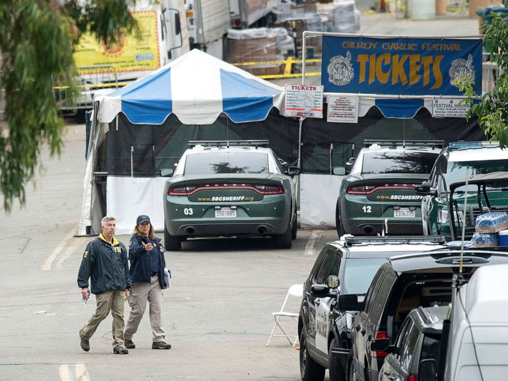 PHOTO: FBI personnel pass a ticket booth at the Gilroy Garlic Festival, July 29, 2019, in Calif., the morning after a gunman killed at least three people, including a 6-year-old boy, and wounded about 15 others.